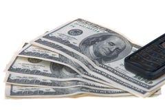 Telefone e dólares Fotos de Stock