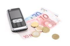 Telefone e dinheiro de pilha Fotografia de Stock Royalty Free