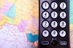 Telefone e mapa Imagens de Stock