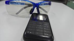 Telefone e olhos Fotografia de Stock