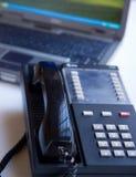 Telefone e portátil Fotografia de Stock