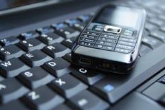 Telefone e portátil de pilha do conceito do negócio foto de stock royalty free