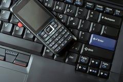 Telefone e portátil de pilha do conceito do negócio imagem de stock royalty free