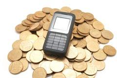 Telefone em moedas Imagem de Stock Royalty Free
