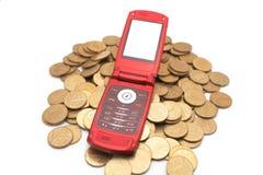 Telefone em moedas Imagens de Stock