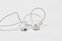 Telefone esperto com fones de ouvido fotos de stock royalty free