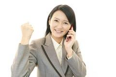 Telefone esperto com mulher Imagens de Stock Royalty Free