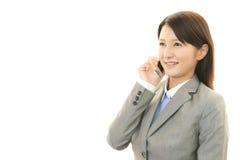 Telefone esperto com mulher Foto de Stock