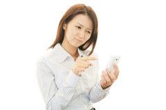 Telefone esperto com mulher Fotografia de Stock Royalty Free