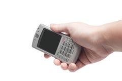 Telefone esperto com teclado QWERTY à disposição Fotografia de Stock Royalty Free