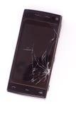 Telefone esperto danificado no fundo branco Imagens de Stock Royalty Free
