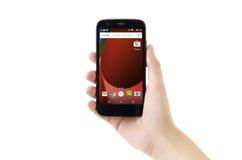 Telefone esperto de Moto G no fundo branco Fotografia de Stock