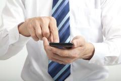 Telefone esperto do toque do homem de negócios foto de stock royalty free
