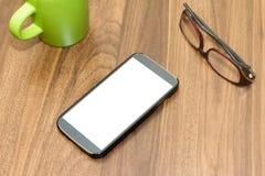 Telefone esperto na tabela Imagem de Stock Royalty Free