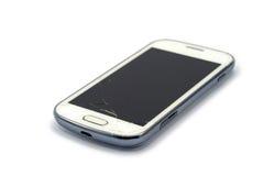 Telefone esperto quebrado isolado no branco Imagem de Stock
