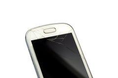 Telefone esperto quebrado isolado no branco Imagem de Stock Royalty Free
