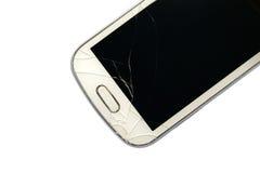 Telefone esperto quebrado isolado no branco Foto de Stock Royalty Free