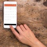Telefone esperto tocante da mão imagens de stock royalty free