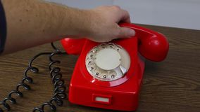 Telefone giratório vermelho de soada video estoque