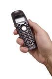 Telefone isolado na mão do homem + no trajeto de grampeamento Foto de Stock