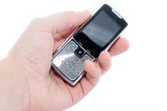 Telefone móvel à disposicão Fotos de Stock Royalty Free