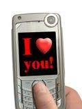 Telefone móvel à disposicão, eu te amo! no indicador imagens de stock royalty free