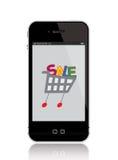 Telefone móvel com carro de compra Fotografia de Stock Royalty Free