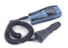 Telefone móvel e carregador Fotos de Stock