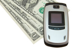 Telefone móvel e dólares cinzentos no branco fotos de stock royalty free
