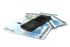 Telefone móvel e dinheiro Fotografia de Stock