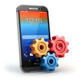 Telefone móvel e engrenagens ajustes Fotografia de Stock