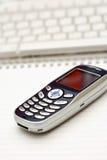 Telefone móvel e teclado Imagens de Stock