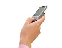 Telefone móvel em uma mão Fotos de Stock