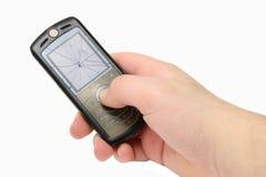 Telefone móvel quebrado com indicador rachado à disposicão Imagens de Stock Royalty Free