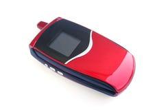 Telefone móvel vermelho sobre um fundo branco Fotos de Stock