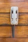 Telefone mais velho que pendura na parede Imagem de Stock