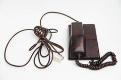 Telefone marrom estacionário do vintage velho com seletor e um tubo foto de stock