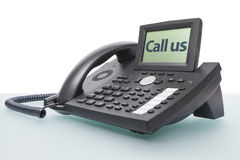 Telefone moderno na mesa de vidro Fotografia de Stock Royalty Free