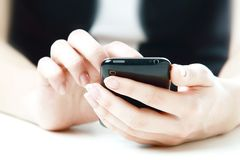 Telefone nas mãos Imagens de Stock Royalty Free