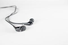 Telefone preto da orelha em um fundo branco Foto de Stock