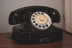 Telefone preto do seletor giratório do vintage imagem de stock