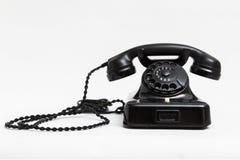 Telefone preto estacionário do vintage velho com seletor e um tubo foto de stock royalty free