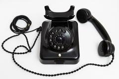 Telefone preto estacionário do vintage velho com seletor e um tubo fotografia de stock royalty free