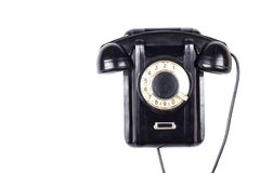 Telefone retro do vintage obsoleto preto velho isolado no fundo branco Fotos de Stock Royalty Free