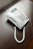 Telefone sobre a mesa marrom Imagem de Stock