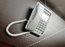 Telefone sobre a mesa marrom Imagens de Stock