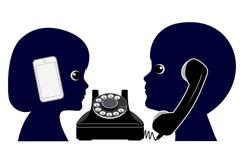 Telefone velho contra o telefone celular Fotografia de Stock