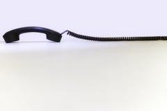 Telefonempfänger mit einer langen Schnur Stockbild
