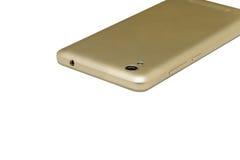 Telefonen är guld- färg Royaltyfri Foto