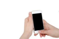 Telefonen är i handen med skärmen i kameran Arkivbilder